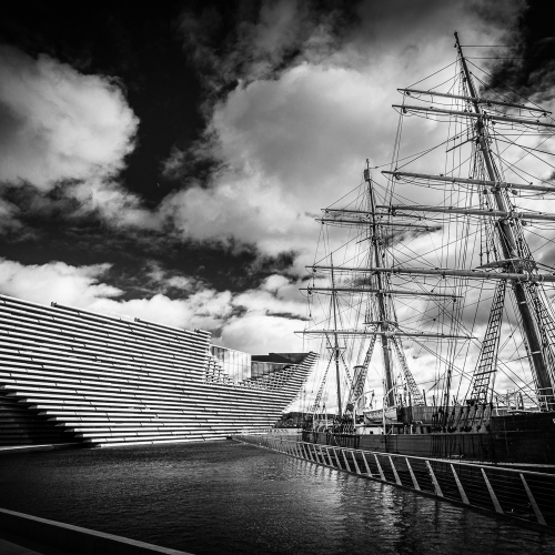 Monochrome (black and white) image of RRS Discovery and the V&A Dundee, Dundee, Scotland. DD023