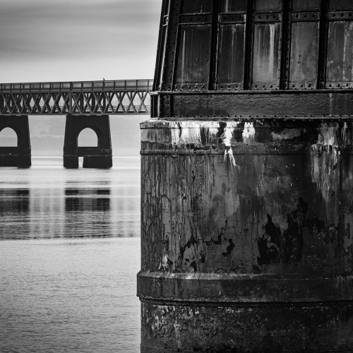 Monochrome image of the Tay Rail Bridge from Dundee, Scotland. DD040