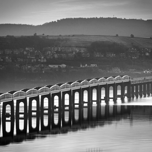 Monochrome image of the Tay Rail Bridge from Dundee, Scotland. DD038