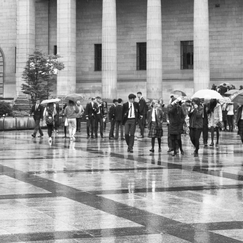 Monochrome (black and white) image of pupils, staff and parents of Dundee High School in City Square, Dundee after the school's graduation ceremony in the Caird Hall. DD010