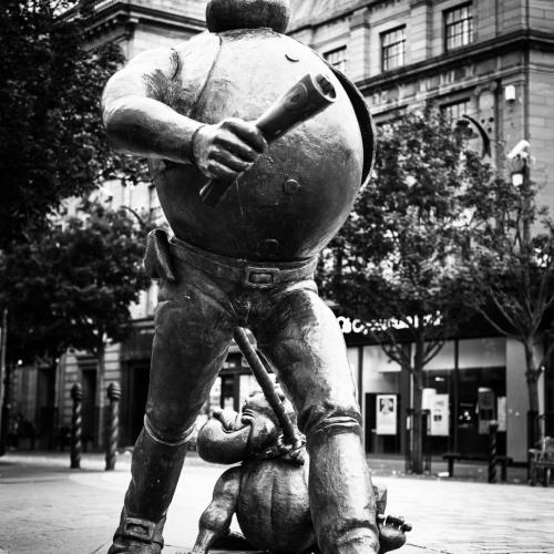 Monochrome (black and white) Desperate Dan statue in Dundee High Street, Scotland. DD017