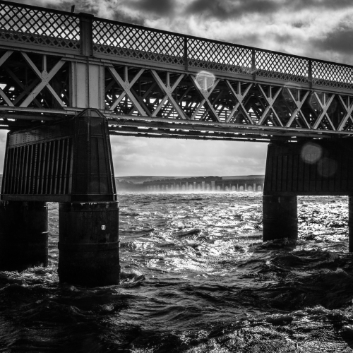 Monochrome (black and white) image of rough water on the Firth of Tay by the Tay Rail Bridge, Dundee, Scotland, United Kingdom. the Firth of Tay around the Tay Rail Bridge, Dundee, Scotland. DD026