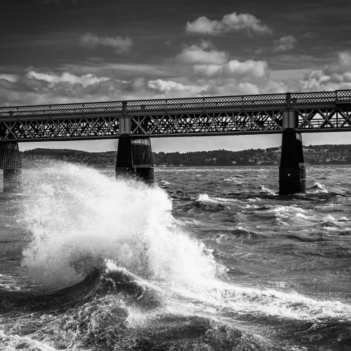 Monochrome (black and white) image of rough water on the Firth of Tay by the Tay Rail Bridge, Dundee, Scotland, United Kingdom. the Firth of Tay around the Tay Rail Bridge, Dundee, Scotland. DD027