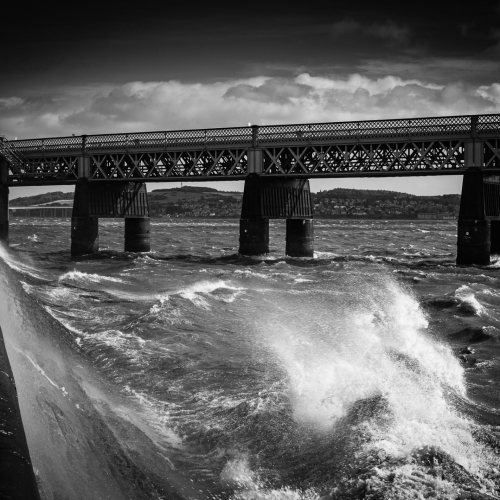 Monochrome (black and white) image of rough water on the Firth of Tay by the Tay Rail Bridge, Dundee, Scotland, United Kingdom. the Firth of Tay around the Tay Rail Bridge, Dundee, Scotland. DD028