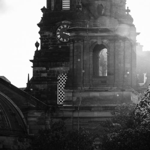 Monochrome (black and white) image of St Cuthbert's Parish Church at the west end of Princes Street Gardens, Edinburgh, Scotland, United Kingdom.
