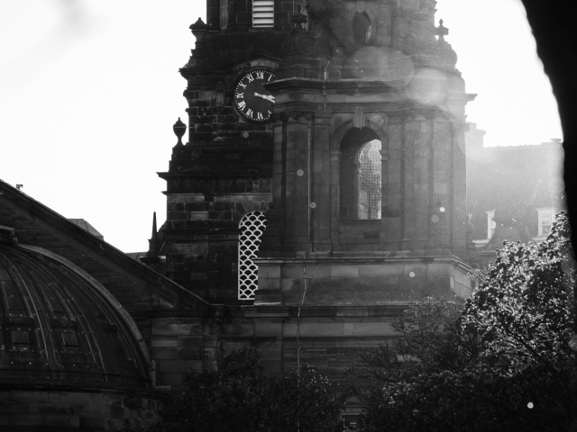 Monochrome (black and white) image of St Cuthbert's Parish Church at the west end of Princes Street Gardens, Edinburgh, Scotland, United Kingdom.