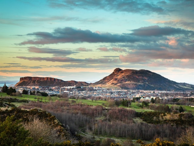Late evening view across South Edinburgh to Arthur's Seat and Salisbury Crags, from the Braid Hills, Edinburgh.