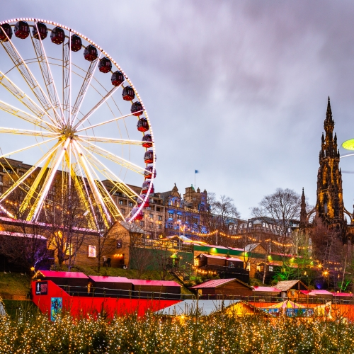 Giant Ferris Wheel and other attractions in Princes Street, Gardens on New Years Day, Edinburgh, Scotland, United Kingdom.
