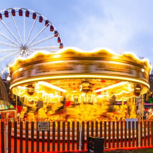 Rotating carousel (roundabout) in Princes Street, Gardens on New Years Day, Edinburgh, Scotland, United Kingdom.