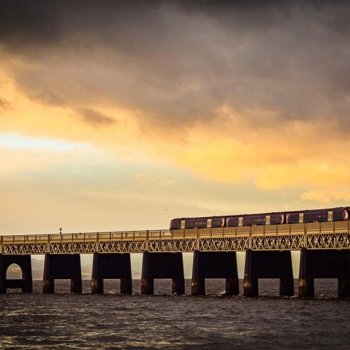 Train crossing the Tay Rail Bridge, Dundee, Scotland. DD045