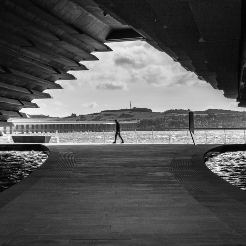 Monochrome (black and white) image of the space under the V&A Dundee Building, Dundee, Scotland, United Kingdom.
