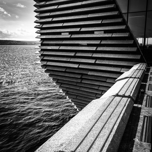 Monochrome (black and white) image of the south-east aspect of the V&A Dundee Building, Dundee, Scotland. DD029