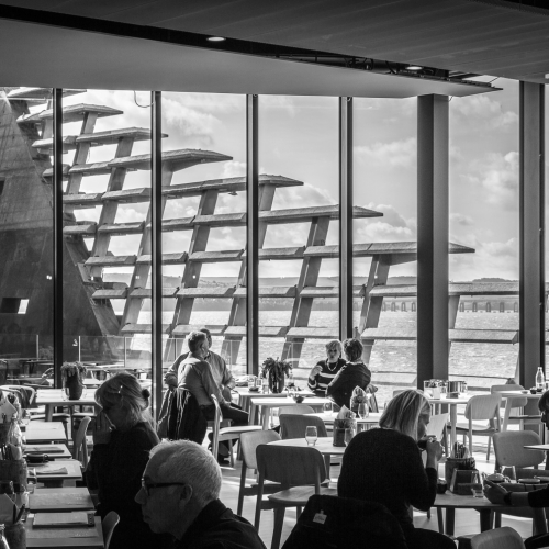 Monochrome (black and white) image of the restaurant in the V&A Dundee Building, Dundee, Scotland. DD030