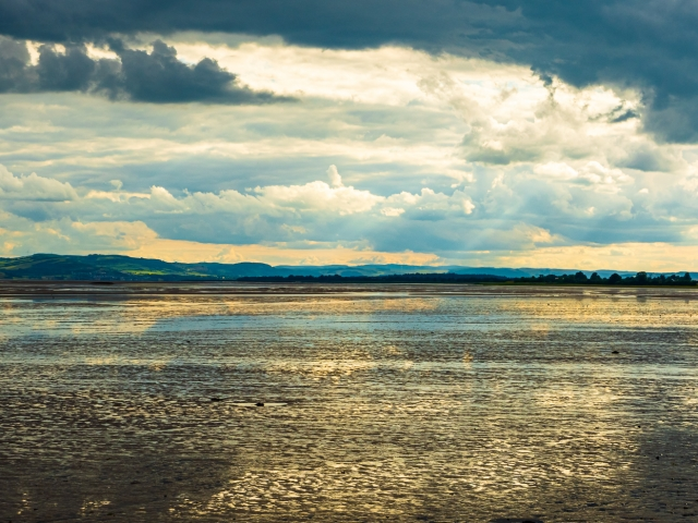Reflection of a dramatic sky on Tay mudflats at low tide, Invergowrie, Scotland. DD101