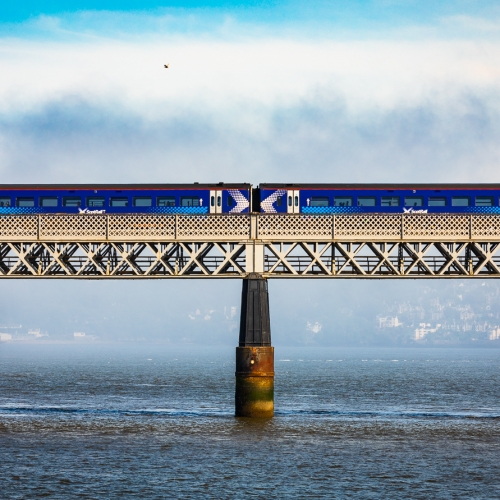 Train passing across the Tay Rail Bridge with a fog bank obscuring the Fife side of the Tay, Scotland. DD083