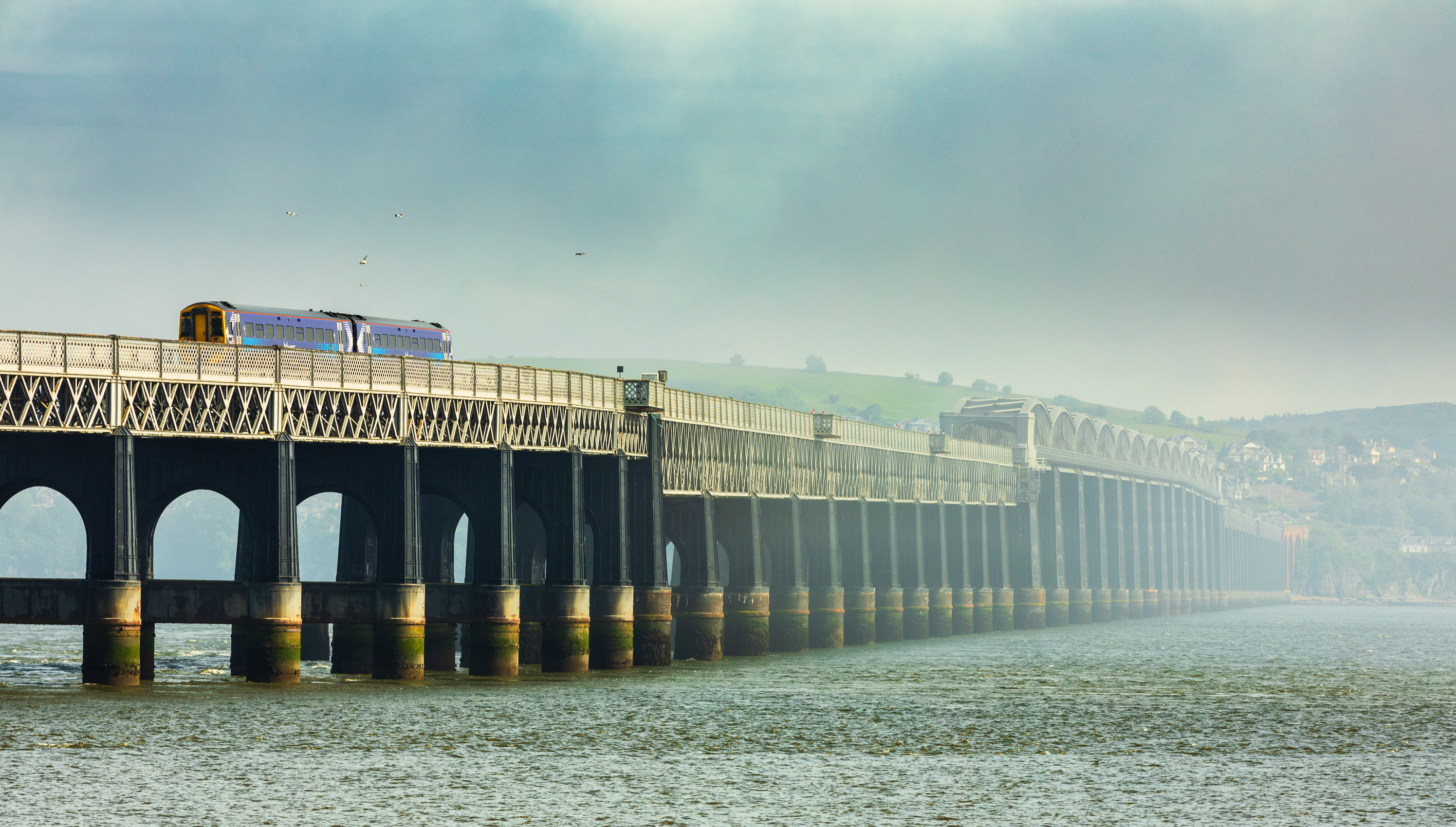 Train passing across the Tay Rail Bridge with a fog bank obscuring the Fife side of the Tay, Scotland. DD084