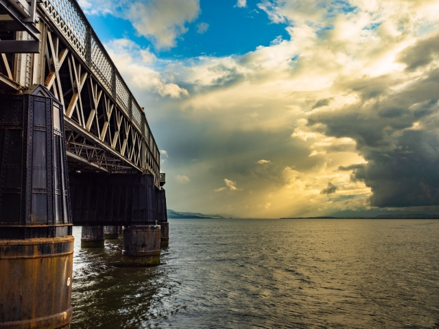 Piers of the Tay Rail Bridge and dramatic cloud formation from Dundee, Scotland. DD098