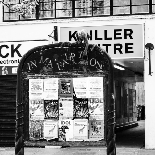 Monochrome (black and white) image of an Information board outside the Keiller Centre, Dundee, Scotland. DD060