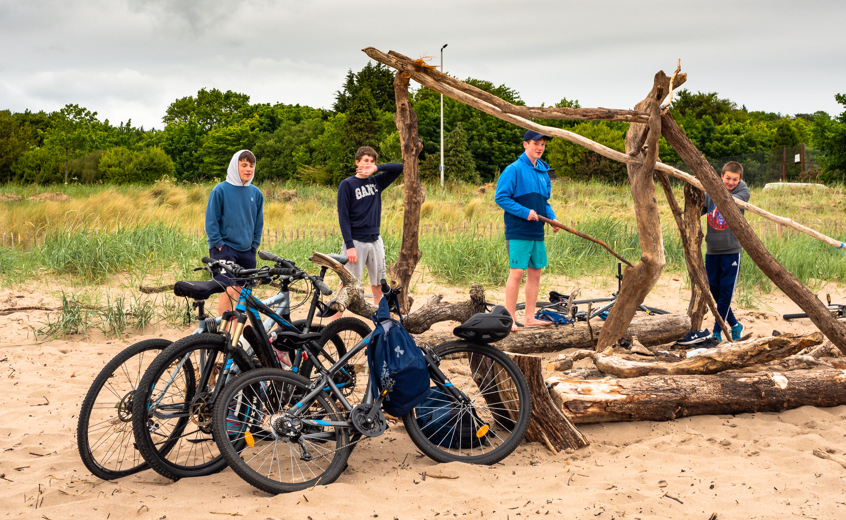 Group of young lads building on Broughty Ferry beach during the Coronavirus lockdown in June 2020, Dundee, Scotland. DD070