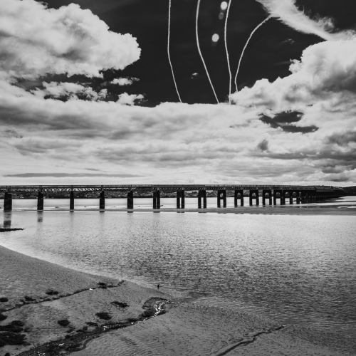 Monochrome (black and white) image of the Tay and the Rail Bridge at low tide from Dundee, Scotland. DD078