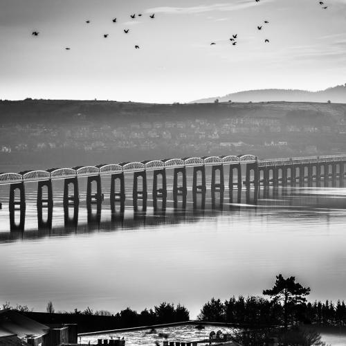 Monochrome image of the Tay Rail Bridge from Dundee, Scotland, United Kingdom.
