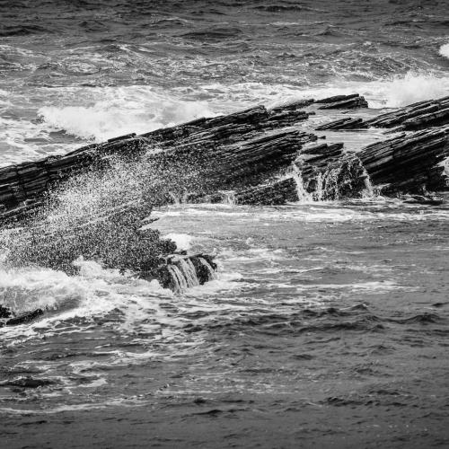 Rocks and sea-spray, Mainland, Orkney Isles, Scotland.