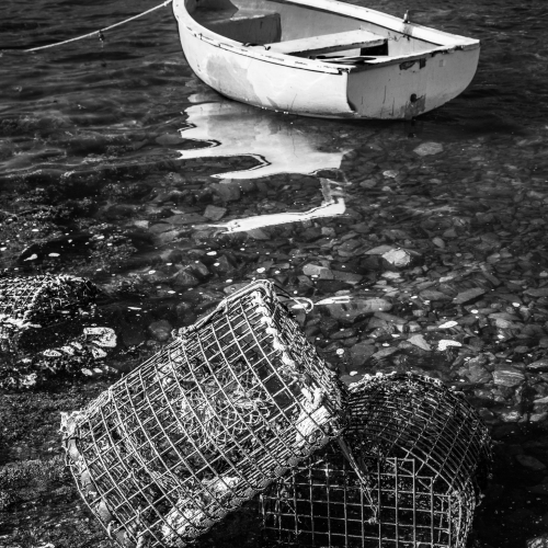 Moored boat and lobster pots, Connemara, Ireland.