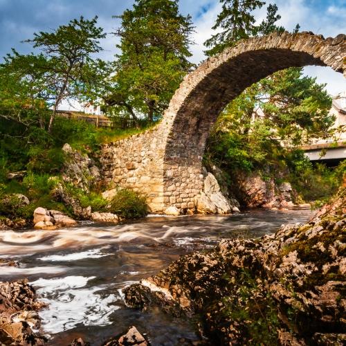 Old packhorse bridge at Carrbridge, Cairngorms National Park, Scotland.