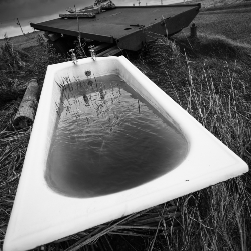 Abandoned bath and trailer on Mainland, Orkney Islands, Scotland.