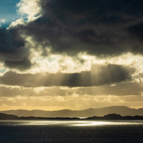 Crepuscular rays over Raasay, Skye and Rona from Applecross, Scotland. AP033