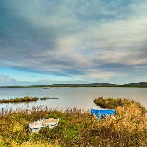 Boats pulled up at the side of the Loch of Harray, Mainland, Orkney Islands. OR003