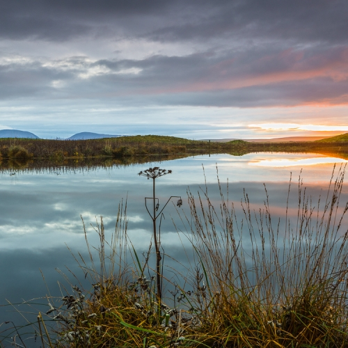 Sunset view across the Loch of Harray toward Hoy, Orkney Islands. OR015