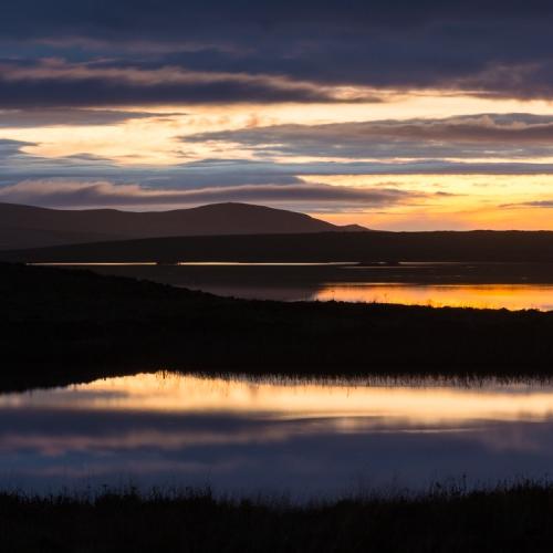 Dusk view across the Loch of Harray toward Hoy, Orkney Islands. OR016