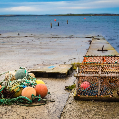 Lobster creels and buoys on a slipway in Kirkwall, Orkney Islands. OR029