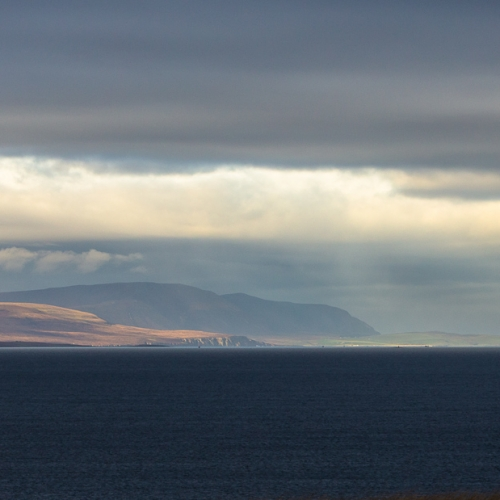 Dramatic weather over Scapa Flow and the island of Hoy, Orkney Islands. OR030