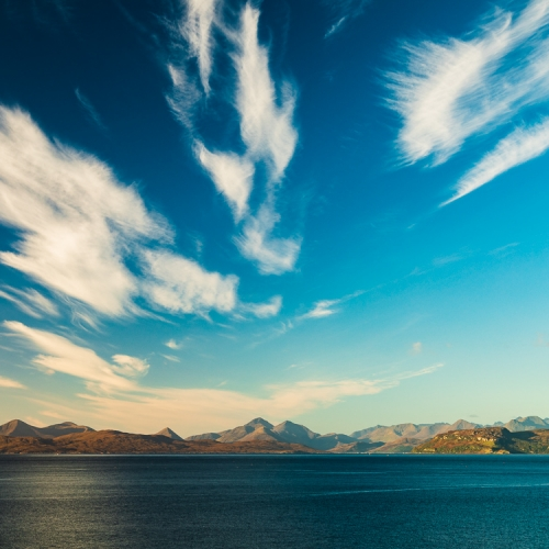 Wind-scattered cloud over Scalpay, Raasay and the Cuillins of Skye from Sand, Applecross, Scotland. AP013