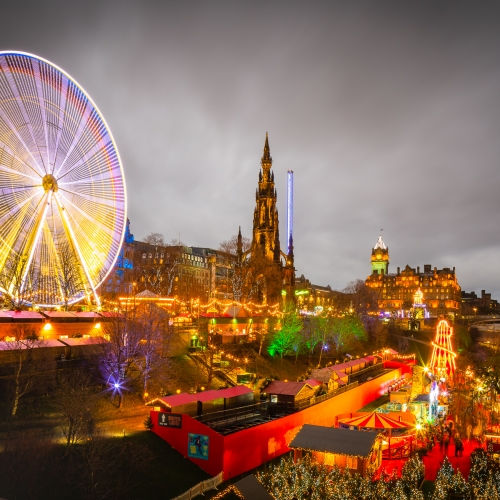 Giant Ferris Wheel and other attractions in Princes Street Gardens on New Years Day, Edinburgh, Scotland, EH007